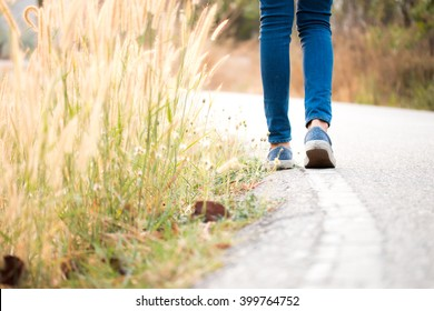 Woman jeans and sneaker shoes
