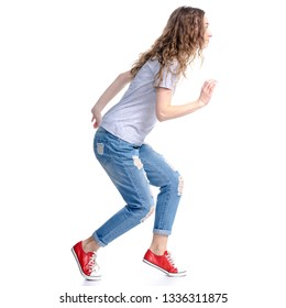 Woman in jeans sneaks sneak up on white background isolation