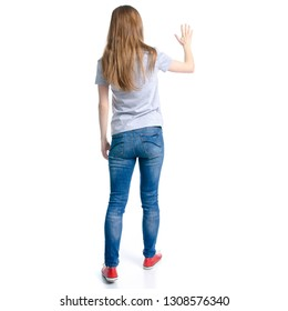 Woman in jeans t-shirt showing holding on white background isolation, back view