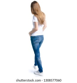 Woman in jeans and white t-shirt standing on white background isolation, back view