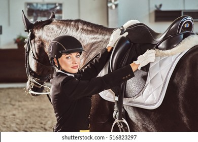 woman jockey with her horse