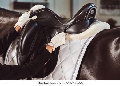 woman jockey with his horse