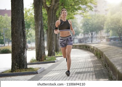 Woman jogger exercising in town