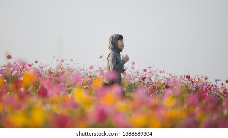 woman jogging in the flowers park