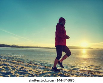 Woman jogging on winter beach run. Female athlete runner jogger training living healthy active exercise lifestyle exercising outdoor on beach