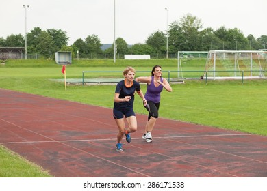 woman jogging outdoor on a racecourse