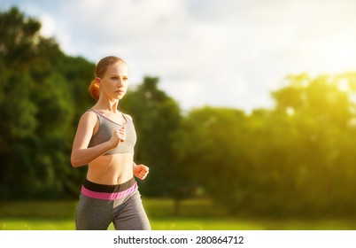 woman jogs runs  along the road on nature