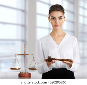 Woman with judge gavel at office. Law and justice concept.