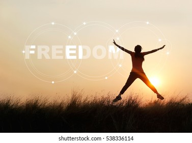 Woman jumping against sunset with word freedom, enjoyment concept