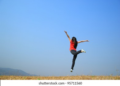 Woman Jumping with blue sky