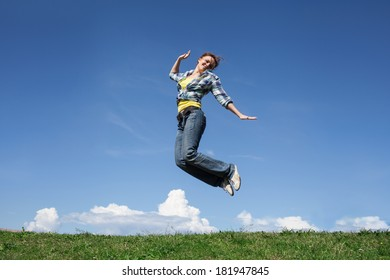 woman jumping at green grass