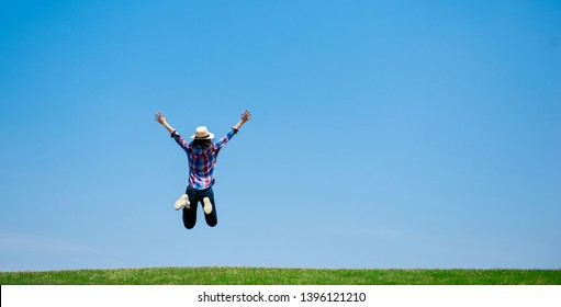 Woman jumping in the meadow