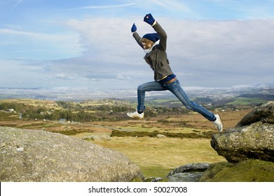 Woman Jumping From Rock To Rock