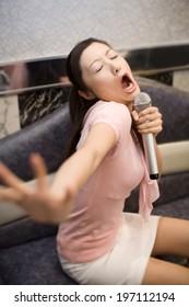 Woman In Karaoke Room