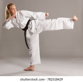 Woman karate actively working legs.