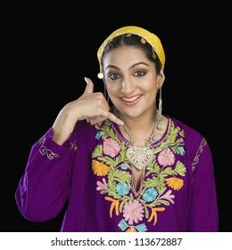 Woman in Kashmiri dress showing call me gesture