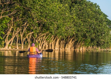 woman in  kayak boat in the water