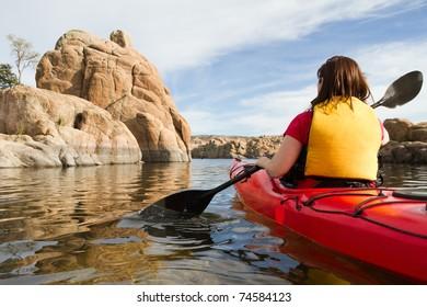 Woman in Kayak Paddling in Lake
