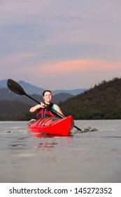 Woman Kayaking on Desert Lake