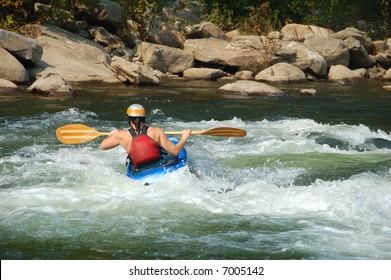 woman kayaking on the Ohio Pyle in Pennsylvania
