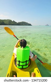 Woman kayaking in the sea.