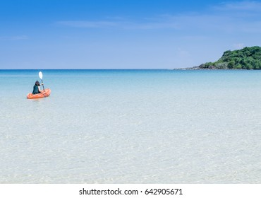 Woman is kayaking in sea ,this image for vacation relaxing concept