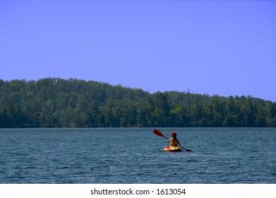 Woman Kayaks on Bay Lake (Brainerd, MN)