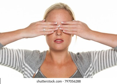 woman keeps her eyes closed