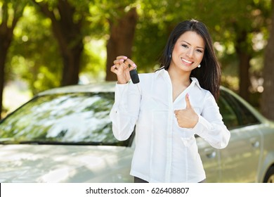 Woman with key of a car.