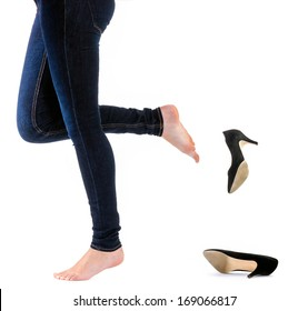 Woman kick off her shoes with white background