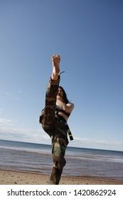 Woman Kicking By the Beach at Prince Edward Island