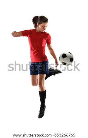 Woman kicking soccer ball with back heel