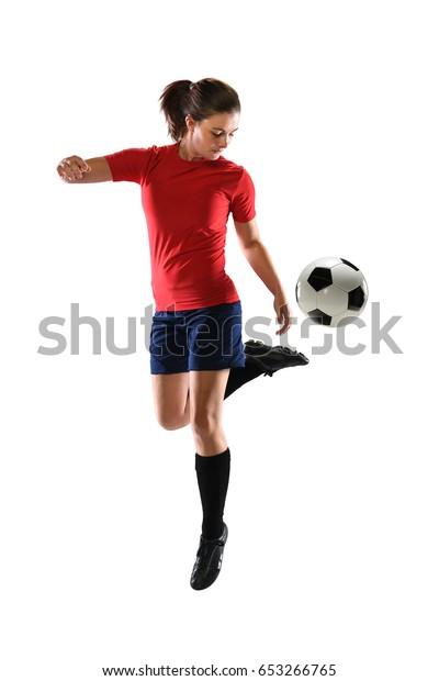 Woman kicking soccer ball with back heel