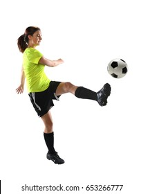 Woman kicking soccer ball isolated over white background