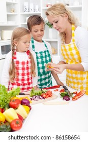 Woman and kids preparing a healthy meal together