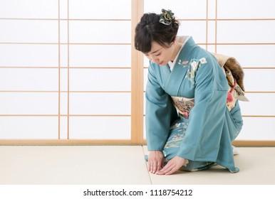 Woman in the kimono bowed