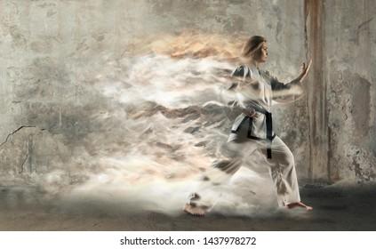 Woman in kimono practicing taekwondo. Modern Korean martial art similar to karate