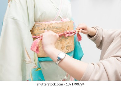 Woman in a kimono(The girls prepare a kimono known as furisode for their coming of age ceremony.)