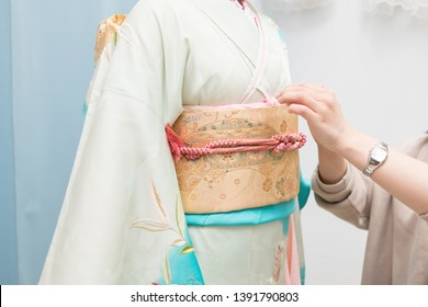 Woman in a kimono(The girls prepare a kimono known as furisode for their coming of age ceremony.)