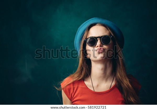 Woman kiss to the camera, duck lips
