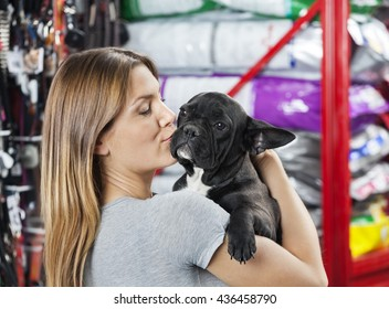 Woman Kissing French Bulldog At Store
