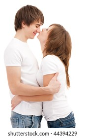 Woman kissing man. Young attractive couple  Young attractive couple