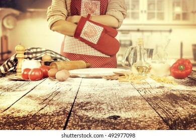 woman in kitchen and big wooden table of space for your food