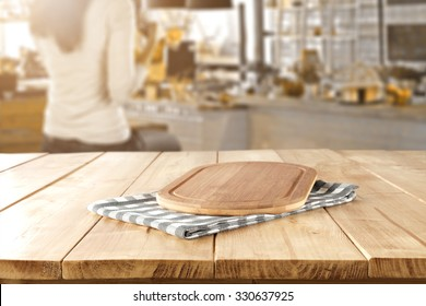 woman in kitchen and kitchen desk space