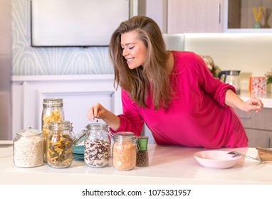 woman in the kitchen and a jar of beans