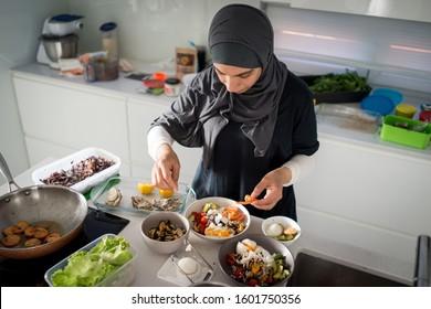 Woman in kitchen preparing healty organic food