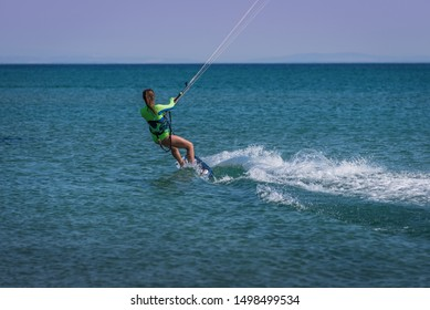 woman kite surfing, white girl kitesurfing on the sea