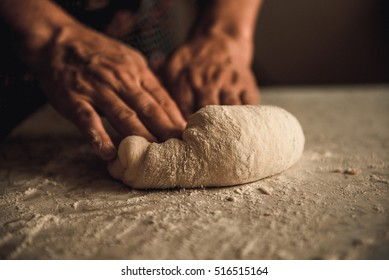 woman knead the dough by hand on pies