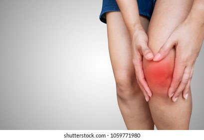 A woman with knee pain. isolated background
