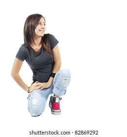 Woman kneeling down looking to her left on white background